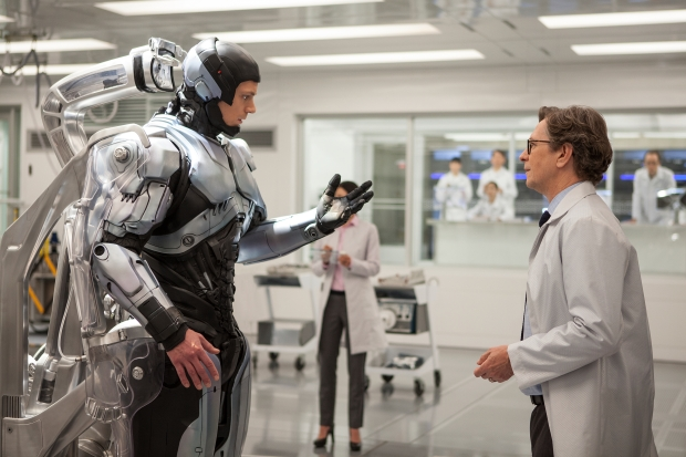 "Joel Kinnaman, left, and Gary Oldman star in Columbia Pictures' ""Robocop."""